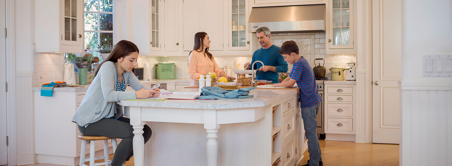 General Lifestyle Family in Kitchen Girl Sitting